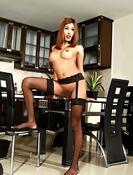 Exotic beauty Fish toying her wet asshole in kitchen