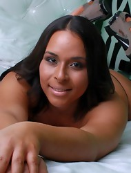 Beautiful Brianna strips on the bed