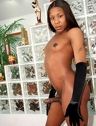 Sexy Summer's little black dress can't hold back her huge cock for long!