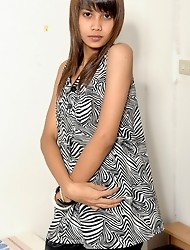 Nay is a horny teen ladyboy from Bangkok with a tight, slender body and some perky hormone titties!